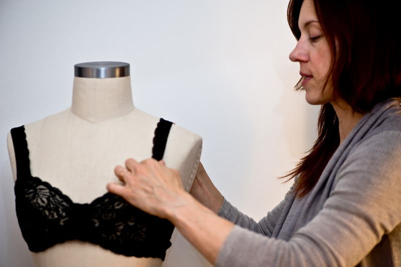 """Norma Loehr making a """"universally flattering"""" black lace bra"""