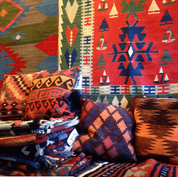 Kilims for sale | Photo courtesy Caffe Kilim and Market Instagram