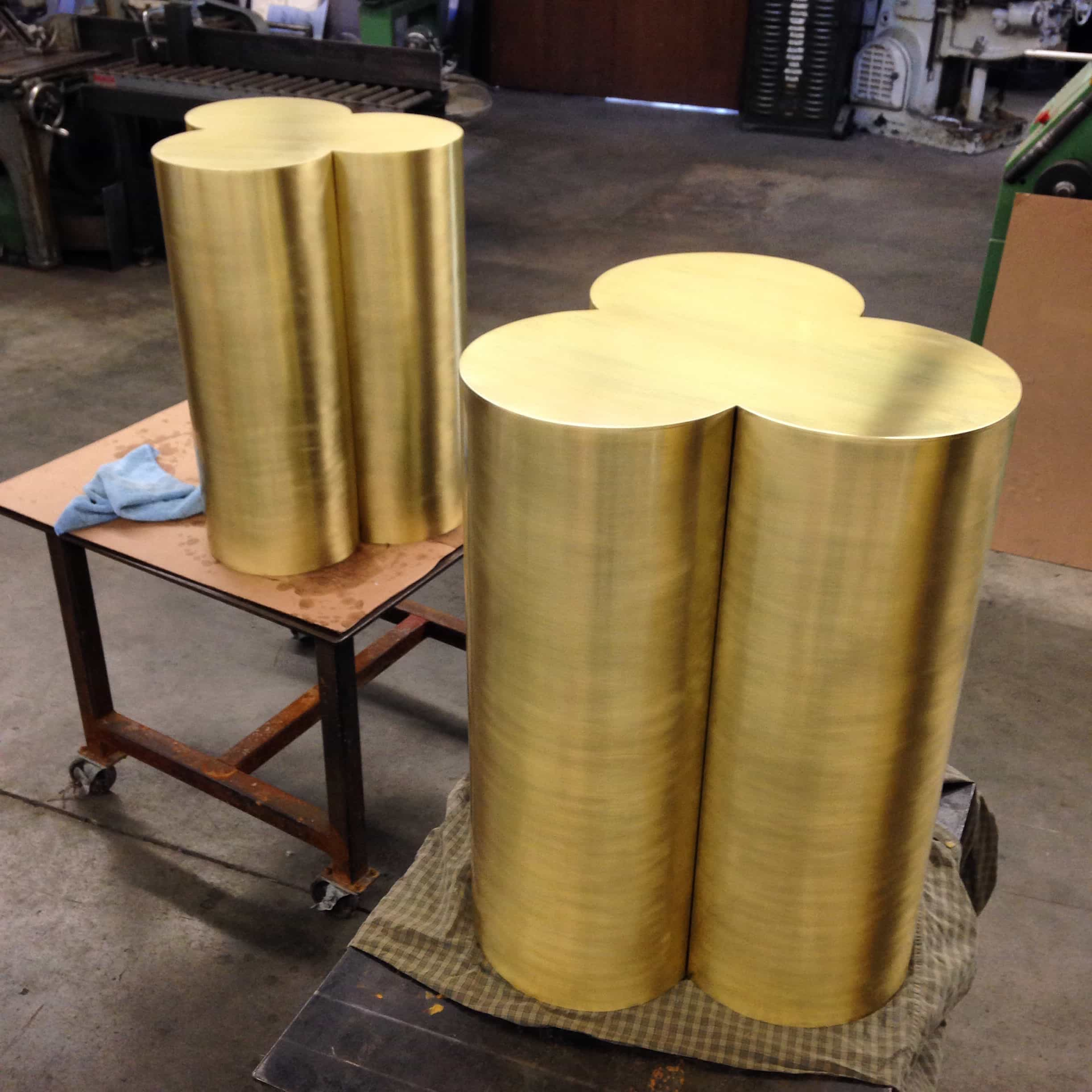 Brass pedestal bases rolled from sheet metal.