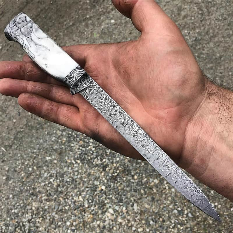 A knife with a handle made of alumilite resin, crafted by Nick Anger. Photo by Nick Anger