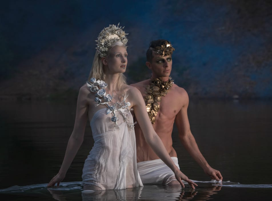On Alena: Silver spike flower crown, $1,300; white rose chestplate, $1,500; on Dylan: Gold flower choker (worn as headpiece), $675; gold flowing flower headpiece (worn as neckpiece), $1,275. Photo by Ian Barnard