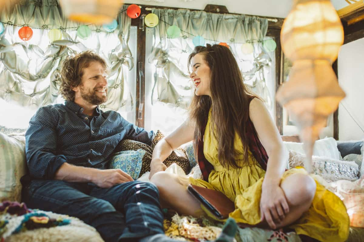 Brendan Batchelder and Chloe Barcelou inside their tiny house. Photo by Chris Saunders