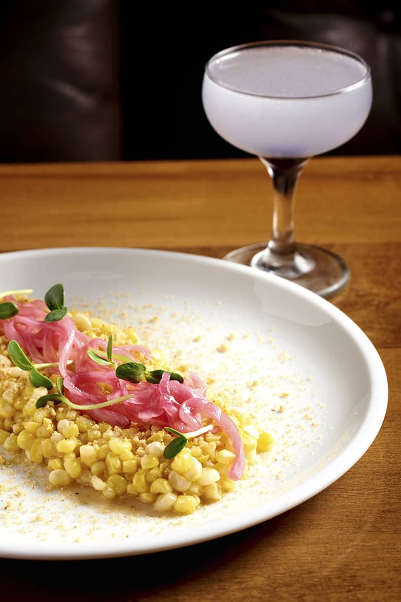 Birch on Elm: The gin-based Aviation cocktail alongside a plate of Grilled Street Corn. Photo by Dominic Perri