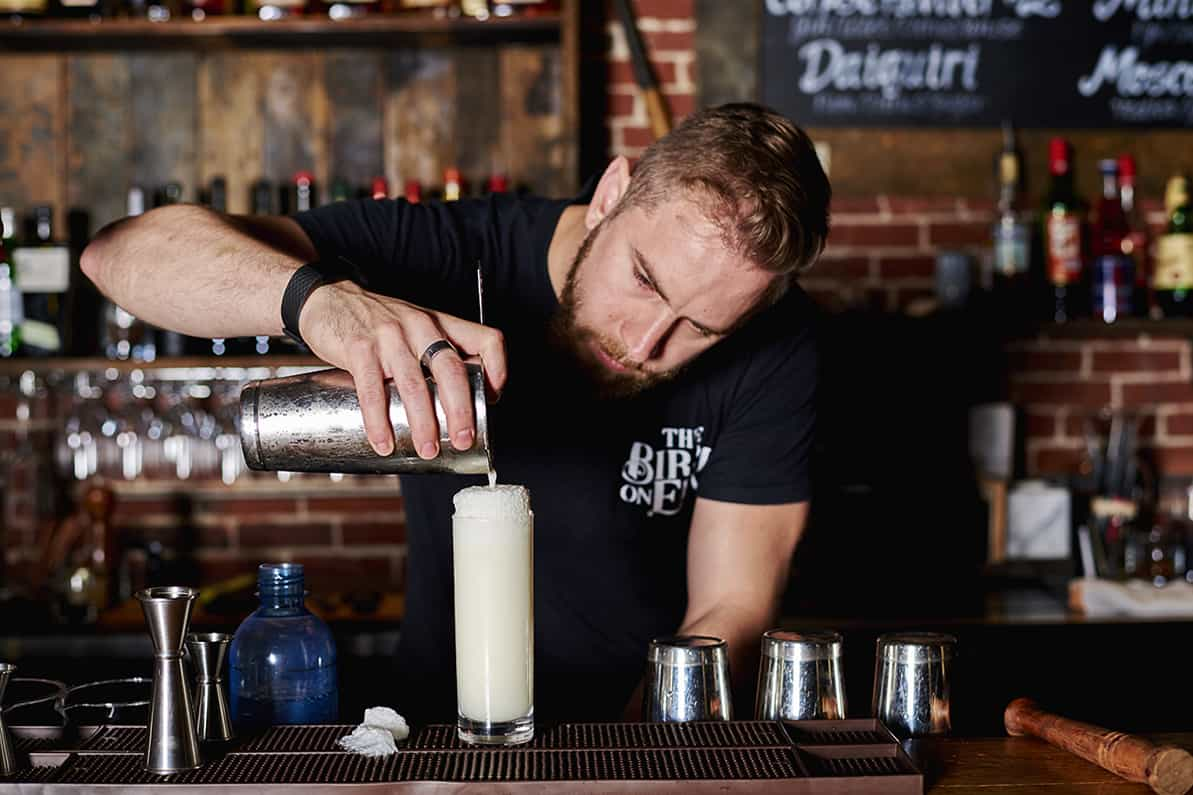 Birch on Elm: Joel Soucy pours a Ramos Gin Fizz. Photo by Dominic Perri