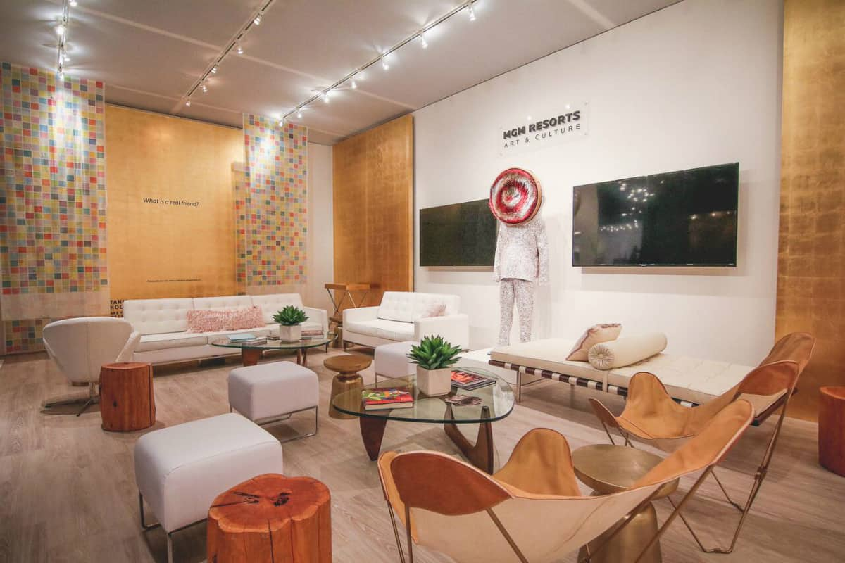 Top photo interior of the collector's loung at Art Basel featuring Nick Cave's sound suit and Tanja Hollander's interactive exhibition entitled Are You Really My Friend presented by MGM Resorts Art & Culture.