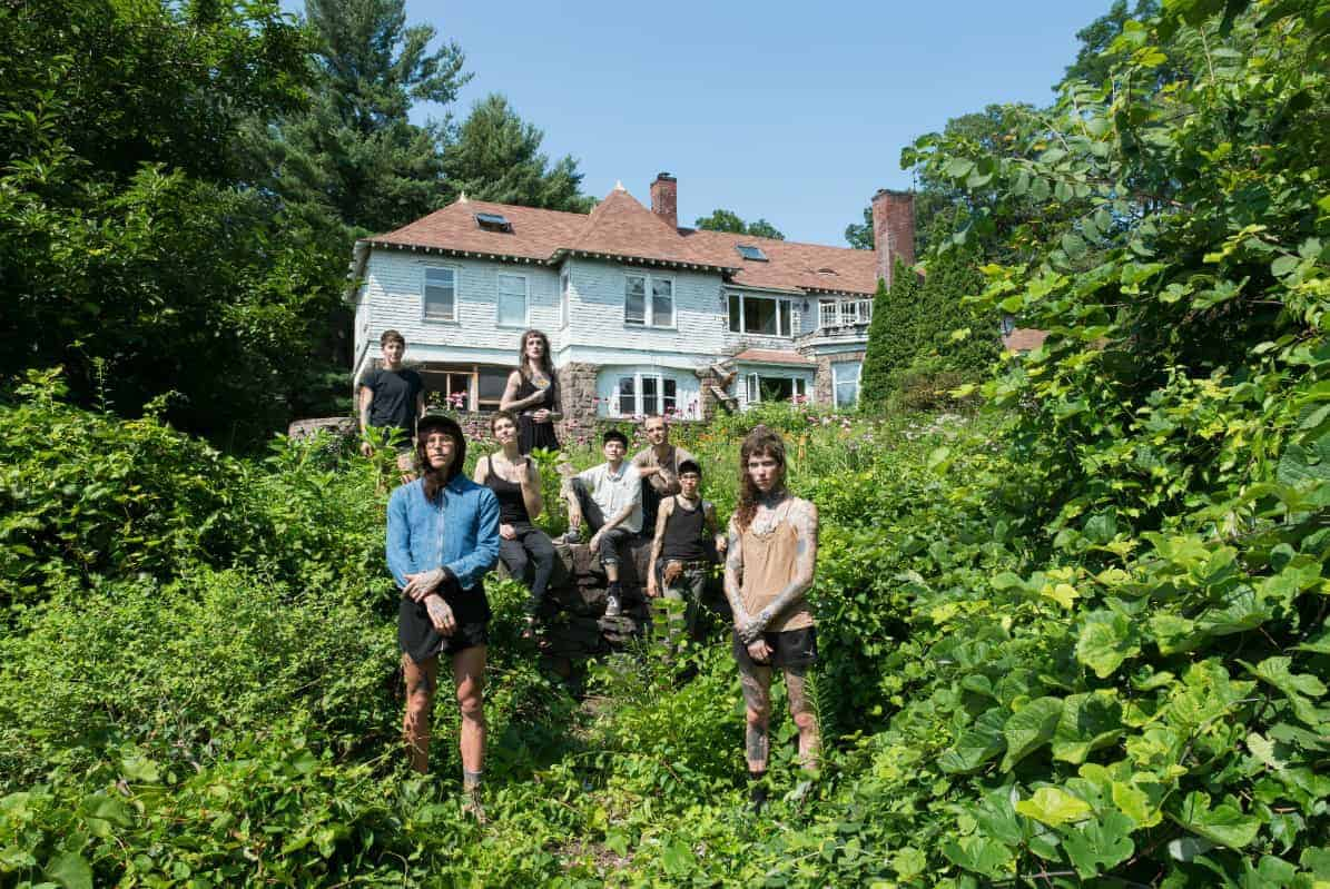 The Lupinewood collective on the grounds of their dilapidated Greenfield, Massachusetts mansion. Photo by Caleb Cole